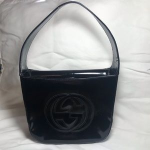 Gucci small black patent leather  handbag